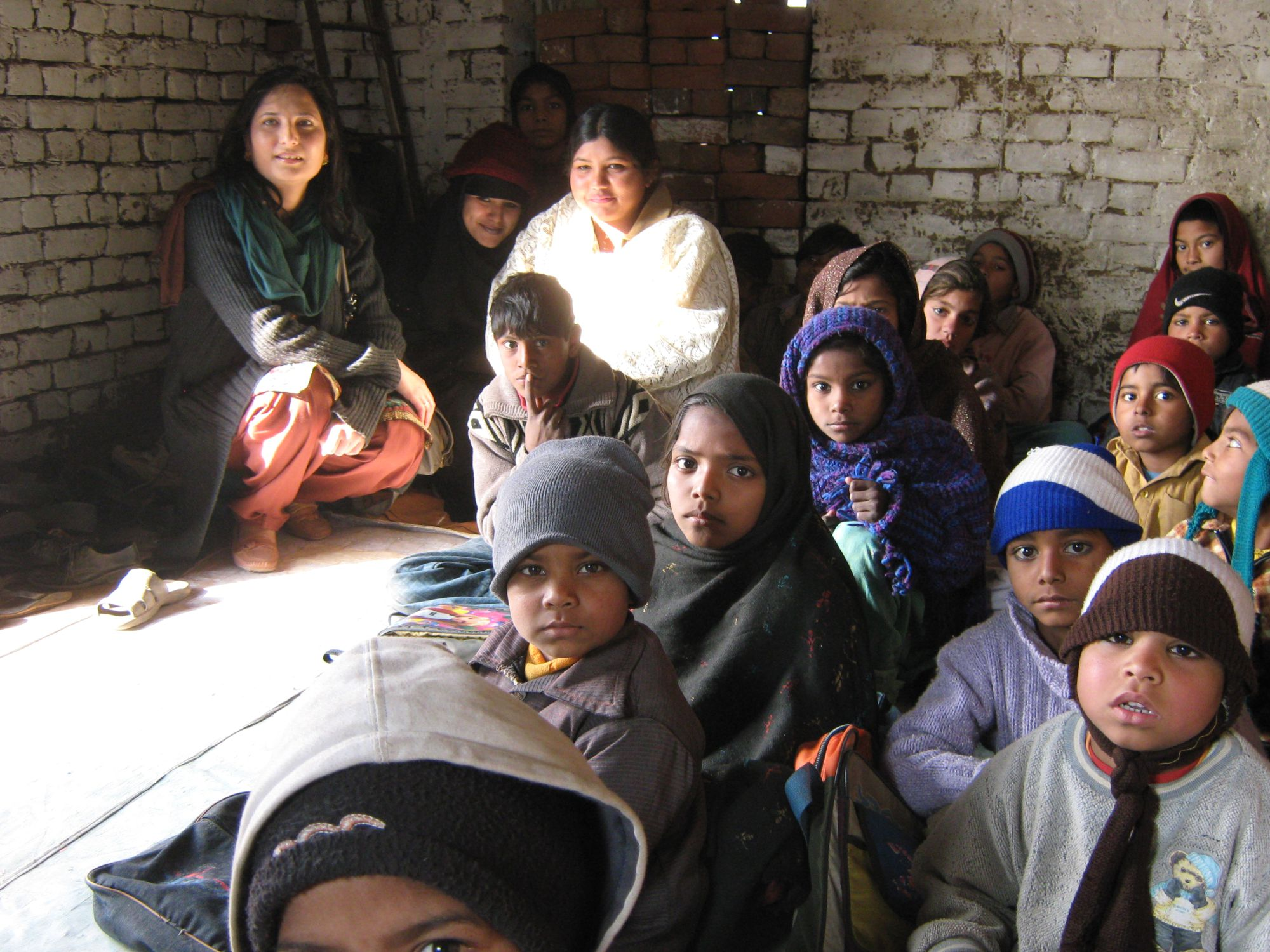This is a starting school in a space provided by the brick kiln owner.